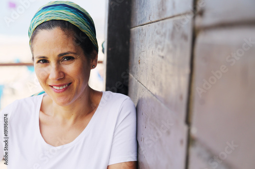 Poster  Portrait of beautiful 40 years old woman outdoors