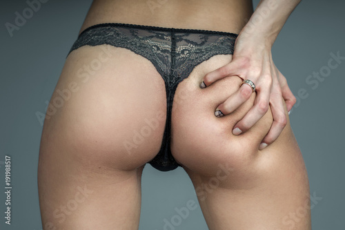 Fotografia  girl in sexy lace panties touching her buttocks