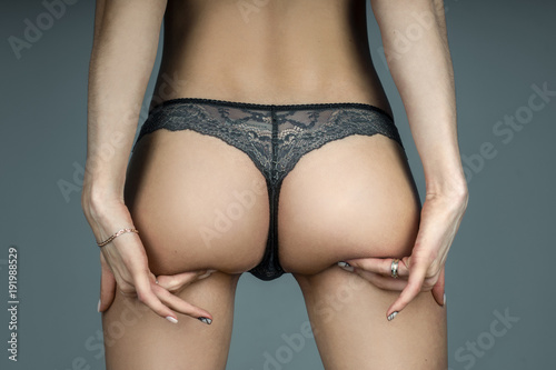 Αφίσα  girl in lace panties touching her sexy buttocks