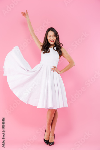 Fotografija  Full length portrait of a happy young asian woman