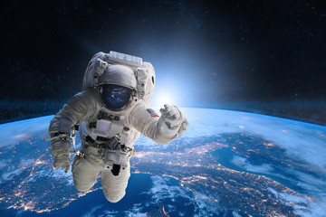 Astronaut in outer space on...