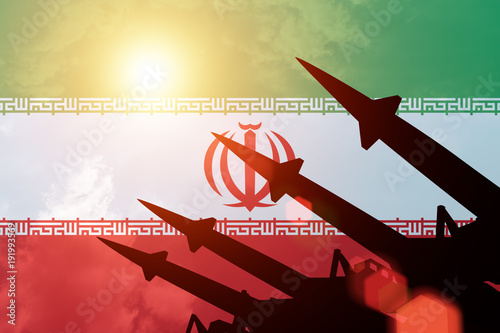 Antiaircraft rockets silhouettes on background of Iran flag Canvas Print