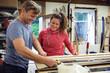 Man and woman in workshop, making ski equipment