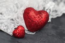 Red Glitter Hearts Over White Lase . Black Background. Valentine's Day Concept.