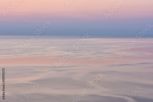 Nice pink sunset seascape in pastel shades, peace and calm outdoor travel background with copy space, motion blur image