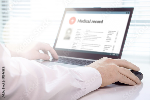 Cuadros en Lienzo  Doctor using laptop and electronic medical record (EMR) system