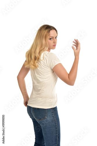 Fototapeta 3/4 portrait of blonde girl wearing white shirt. isolated on white background. obraz na płótnie