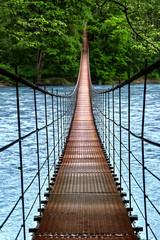 Fototapeta Optyczne powiększenie Suspension bridge. Landscape view of Long Steel Suspension bridge above the river. balance