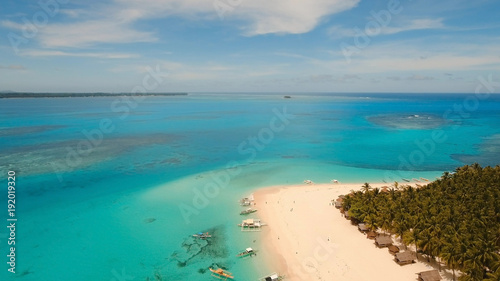 Fotobehang Tropical strand Aerial view of beautiful tropical island Daco with white sand beach. View of a nice tropical beach from the air. Beautiful sky, sea, resort. Seascape: Ocean and beautiful beach paradise. Philippines