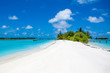 Beautiful sandy beach and over water tropical bungalo