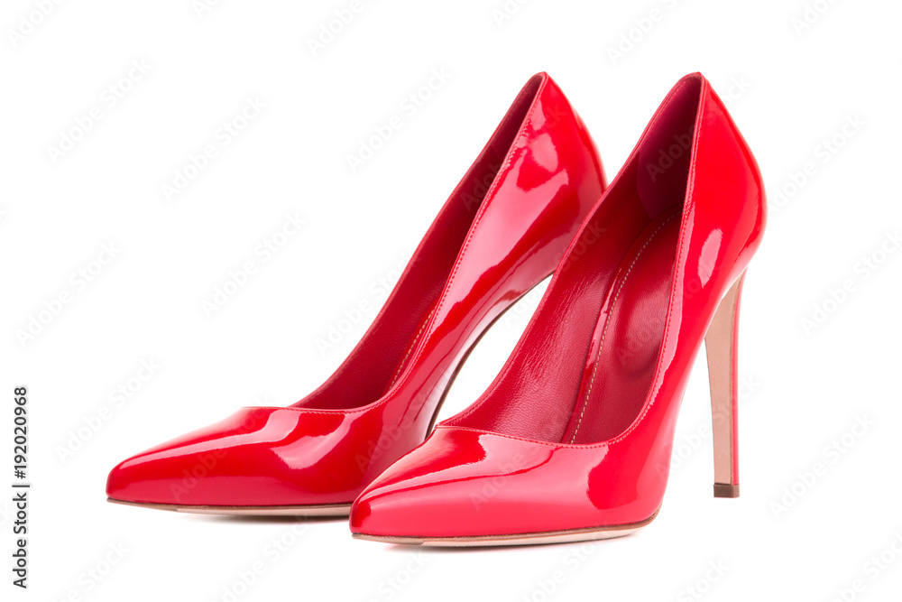Fototapeta Women's shoes in red patent leather. Red high-heeled shoes.