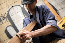 Man Carving A Boat Oar