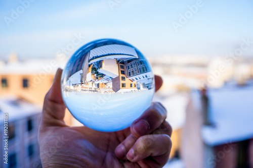 Fotografie, Obraz  A hand holding a crystal ball for optical illusion