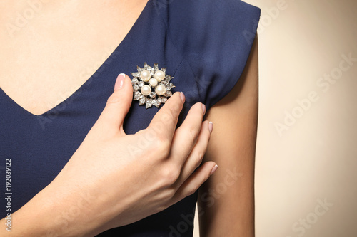 Slika na platnu Beautiful young woman with elegant jewelry on color background, closeup