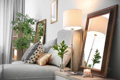 Elegant room interior with mirror on nightstand Fototapeta