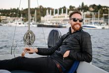 Man In Sunglasses Drives Sailb...