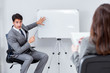 Business presentation in the office with man and woman