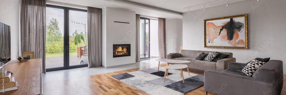 Fototapeta Spacious living room with sofa