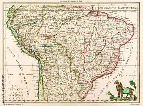 Photo  Antique map of South America, 1812, with two llamas