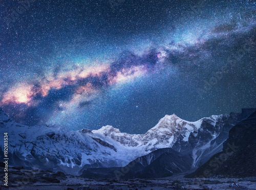 Obraz Space. Milky Way and mountains. Fantastic view with mountains and starry sky at night in Nepal. Mountain valley and sky with stars. Beautiful Himalayas. Night landscape with bright milky way. Galaxy - fototapety do salonu