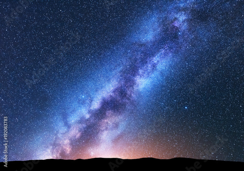 Foto op Canvas Zwart Milky Way. Fantastic night landscape with bright milky way, sky full of stars, yellow light and hills. Shiny stars. Beautiful scene with universe. Space background with starry sky. Astrophotography