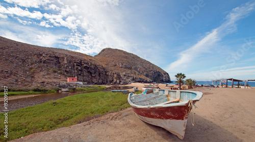 Small fishing boat / ponga at Punta Lobos beach on the coast of Baja California Canvas Print