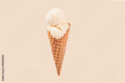 Fotomural Vanilla ice cream cone on white background.