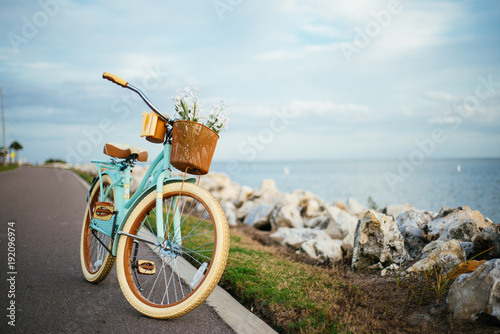 Staande foto Fiets Bicycle by the beach