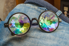 Designer Glasses With Kaleidoscope Glasses On Jeans