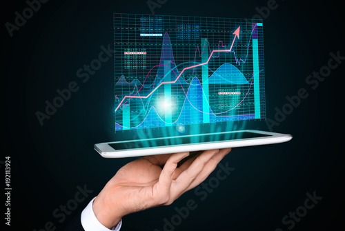 Stock exchange broker with tablet on dark background Canvas Print