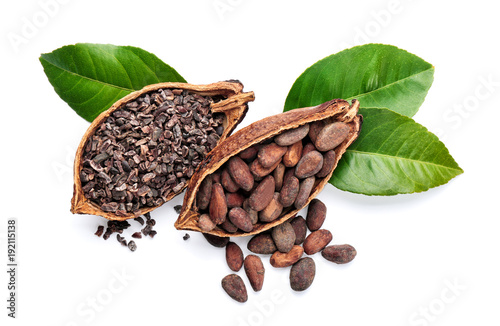Halves of ripe cocoa pod with beans and nibs on white background