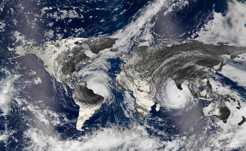 Foto op Plexiglas Wereldkaart Hurricane over the world map silhouette, elements of this image furnished by NASA