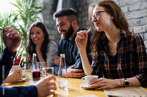 Obraz Happy young friends hangout in coffee shop - fototapety do salonu