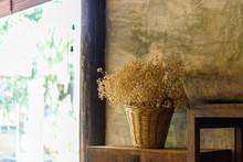 Dry Flower In Basket Beside Th...