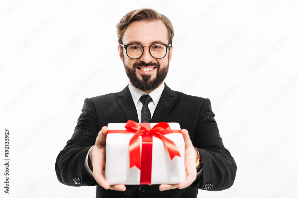 Fototapeta Handsome businessman gives you a gift present box.