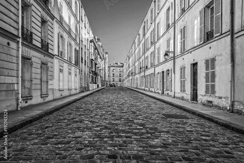 Valokuvatapetti Picturesque cobbled street in Paris, France