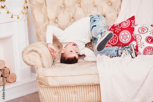 Amazing A Cute Boy Is Tumbling On The Couch A Sporty Guy In A White Gmtry Best Dining Table And Chair Ideas Images Gmtryco