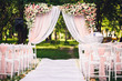 canvas print picture - Decor wedding ceremony in the summer in the park: an arch, chairs, flowers, path.