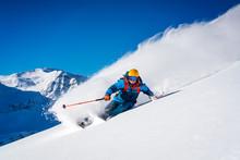 Freeride Skier Seen In Action In Fresh Powder Snow In The Sportgastein Ski Area In Austria.