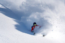 Man Skiing Down Slope
