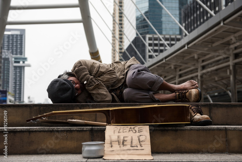 Valokuva  beggar or Homeless man sleep in city at winter