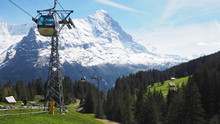 View Of Cable Car To Grindelwald First With Alps Mountains In The Background, Grindelwald, Switzerland May 2017
