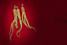 Dry Ginseng Roots On Red Backg...