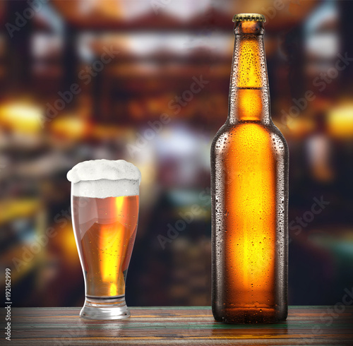 Staande foto Bar bottle is glass of fresh beer on the table of a brewery