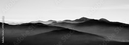 Tuinposter Wit Mountain landscape in sutton, black and white with mist on background