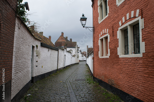 Brick houses and cobblestone streets of the Beguinage in Ghent, Flanders, Belgiu Poster