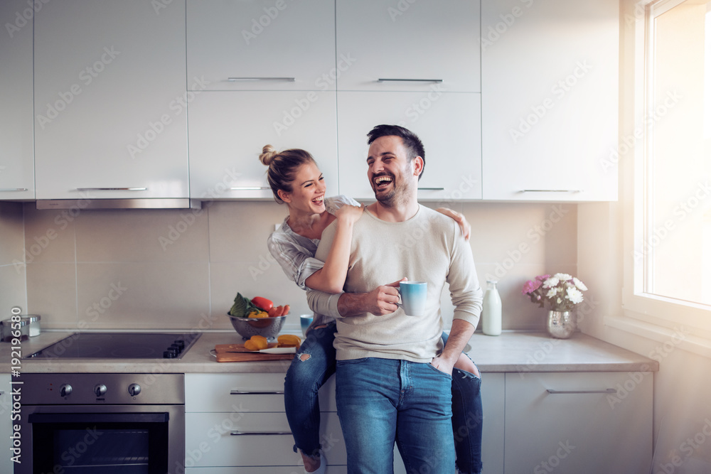 Fototapety, obrazy: Romantic young couple cooking together in the kitchen