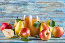 Fresh Organic Farm Pear-apple Juice In Glass With Raw Whole Sliced Pears And Apples On Woody Background.