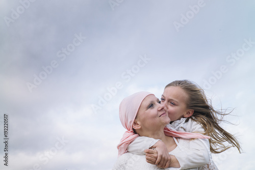 A woman with cancer is  next to her daughter Canvas Print