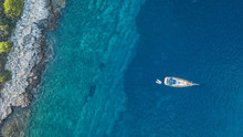 Aerial View Of Anchoring Yacht Next To The Island.